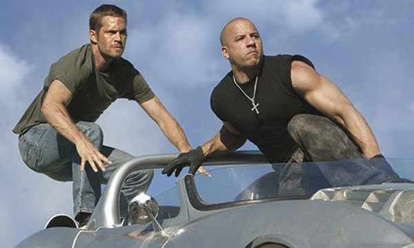 Walker, left, with Vin Diesel in Fast & Furious 5, 2011.